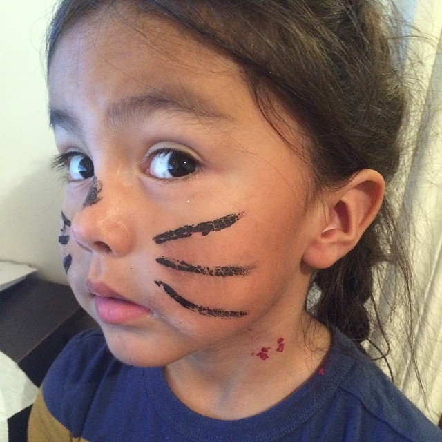 We didn't go anywhere for Halloween here, but the kids painted their faces. JW is a cat, with vampire bites.